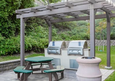 Pet-friendly Picnics at the BBQ Area with two grills, picnic table, and grass