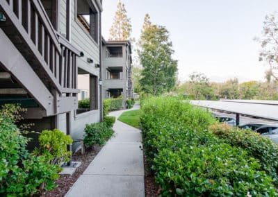 Lush landscaped pathways along the parking and exterior of the building